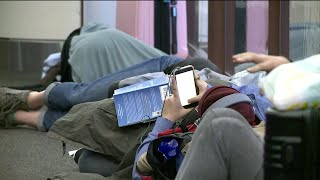 Snowstorm leads to flight cancellations, strands travelers at DIA