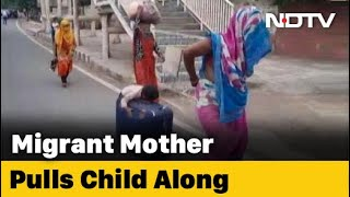 Boy sleeps on suitcase wheeled by mother: video tells migr..