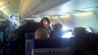 Cop physically pulled white women off plane. Arrested off the plane. copyright