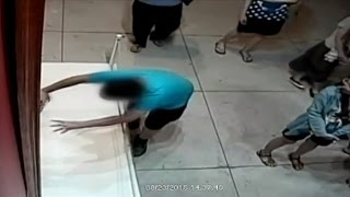 Watch a Boy Accidentally Punch A Million Dollar Painting