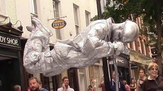 Silver man secret revealed London street performer, floating and levitating trick