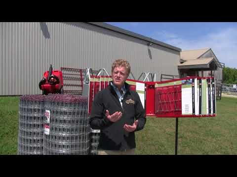 farmer standing infron of wire fencing