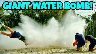 GIANT WATER BOMB Vs. NERF BLASTERS!