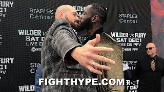 TYSON FURY GETS ALL UP IN DEONTAY WILDER'S FACE; WILDER STARES HIM DOWN AND TRADES WORDS