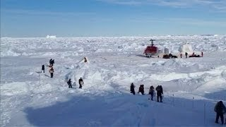Antarctica: stranded crew evacuated from stranded ship via helicopter