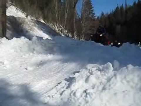 Polaris Sportsman Track ATV in snow and some mud