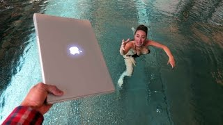 ANGRY BROTHER THROWS MACBOOK PRO IN POOL !!