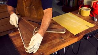 Watch the Trade Secrets Video, A kitchen cutting board makes a great binding jig!