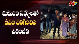 Megastar Chiranjeevi lighting lamps along with family memb..