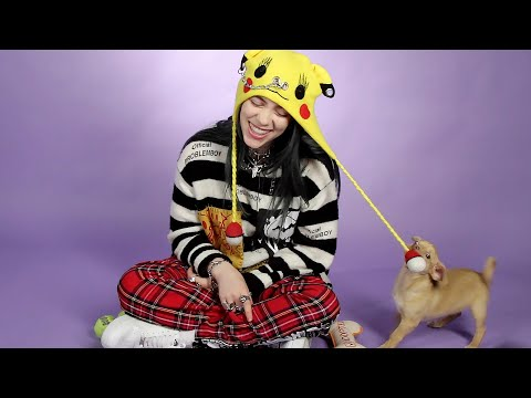 Billie Eilish Plays With Puppies While Answering Fan Questions