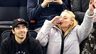 Sophie Turner Dabs and Chugs Red Wine at Hockey Game and It's Amazing