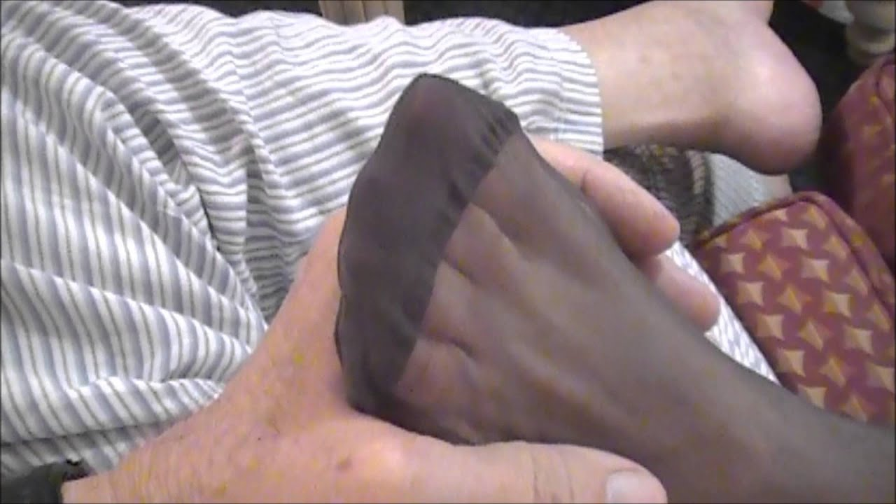 Foot massage with pantyhose