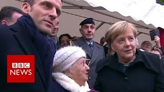 Old lady mistakes Chancellor Merkel for Macron's wife - BBC News