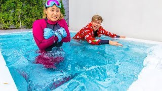 I FROZE MY SWIMMING POOL WITH 7,000 POUNDS OF ICE!!