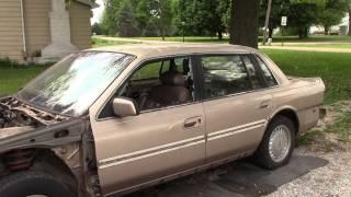 Breaking Car Windows With A Crowbar