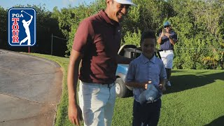 Tony Finau surprises young fan by playing a hole with him