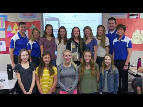 Two-time Olympian and pro distance runner Molly Huddle surprises senior Brie Oakley (Grandview High School, Aurora, Colo.) with the 2016-17 Gatorade National Girls Cross Country Runner of the Year Award inside Brie's first hour stats class Tuesday, January 31, 2017. Brie and her classmates were in the middle of solving a question breaking down her odds on winning the Gatorade Colorado state award when Molly walked in with the trophy. (Credit/Gatorade)