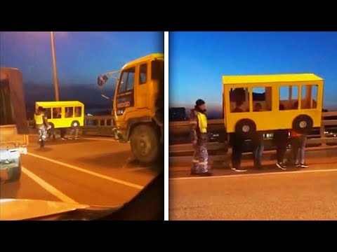 People Disguised as Bus Try to Cross Vehicles-Only Bridge on Foot