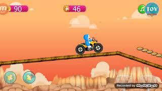 trò chơi Doremon lái xe vượt địa hình lụm bánh rán - doraemon race game