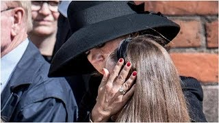Crown Princess Mary pictured consoling daughter at funeral