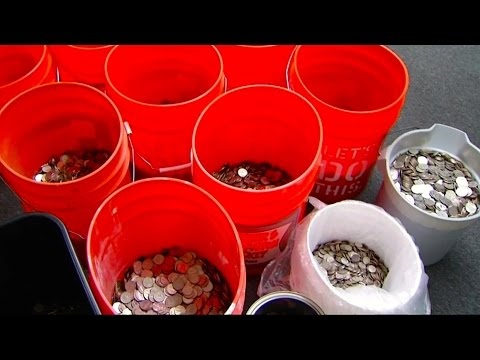 Insurance Company Pays Settlement in Buckets of Coins