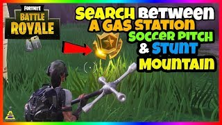 Search between a Gas Station Soccer Pitch And Stunt Mountain Location Fortnite PS4 XboxOne Switch