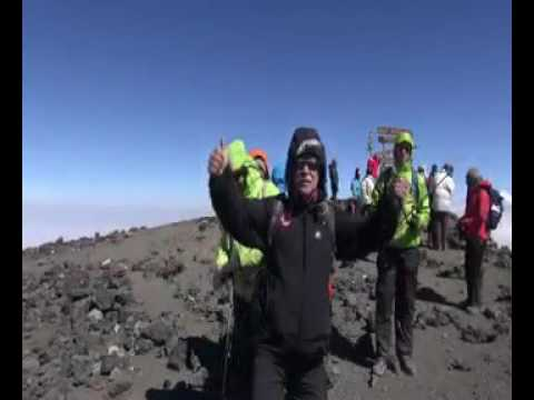 A Great Moment Summit On Top Of Mount Kilimanjaro