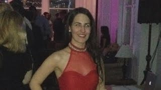 Woman, 29, Died After Falling Off Escalator Trying To Catch Twin Sister's Hat