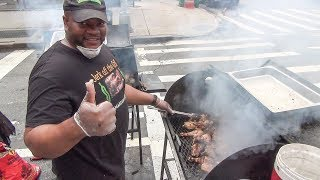 New York Street Food. Jamaican Jerk Chicken, Huge Sausage and Skewers