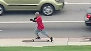 Man tries to flee from a car chase on a longboard