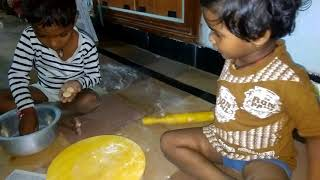 Little baby 2years old making chapati