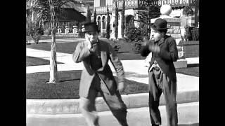4 - Charlie Chaplin - Dia chuvoso - 1914