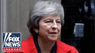 May defends Brexit after surviving no-confidence vote