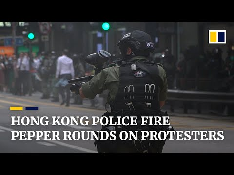 Hong Kong police fire pepper rounds at protesters opposing national anthem law