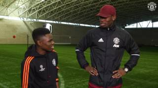 Paul Pogba gives Manchester United Foundation volunteer the Christmas surprise of his life