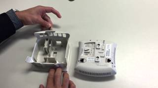 How to unmount an Aruba IAP 105 Access Point from the mounting bracket