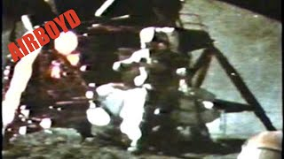 Courtesy: NASA At the end of the last Apollo 15 moon walk, Commander David Scott (pictured above) performed a live demonstration for the television cameras. He held out a geologic hammer and a feather
