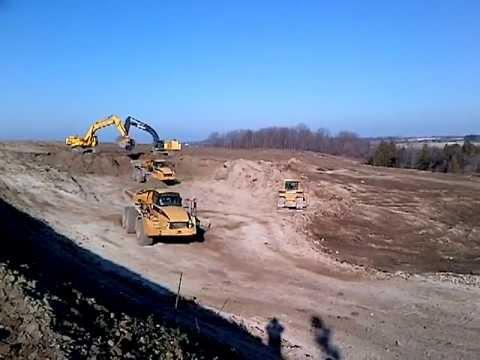 Two 450D John Deere Excavators Loading 740 Cat Rock Trucks
