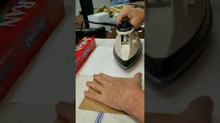 Applying a paper napkin to a card with cling wrap