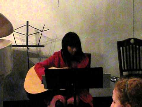 "My student Jenny R. performs ""Hot Cross Buns"" and ""Twinkle Twinkle Little Star"" on guitar at the Musicality Network recital November 9, 2013"