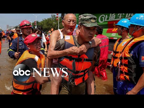 China floods, the Dixie Fire and a Lebanon blast monument: World in Photos, July 27