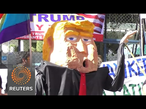 Mexicans build makeshift wall around US embassy in Trump protest