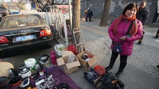 Beijing migrant evictions: thousands forced from homes as winter sets in