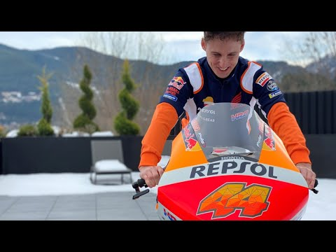 Pol Espargaró shows off his Repsol Honda Team motorbike and colours