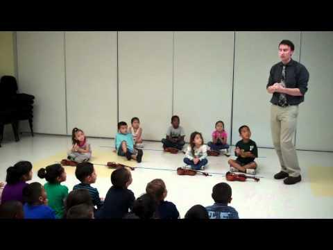 Students Demonstrating Their Violin Skills