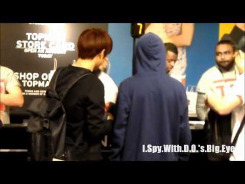 120622 EXO-K In London - D.O. & SUHO waiting at Topshop/Topman Checkout