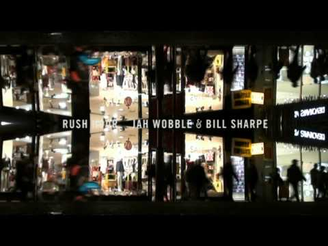 Jah Wobble and Bill Sharpe - Rush Hour online metal music video by JAH WOBBLE