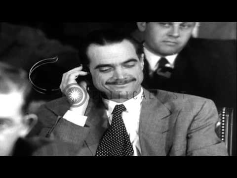 Howard Robard Hughes, Jr. listens to testimony during Senate Hearings,1947 in Was...HD Stock Footage