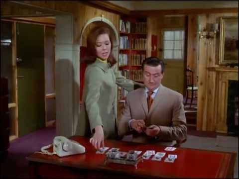 Youtube video - Steed is playing Solitaire when Emma drops round. He shows her a card trick - the two cards she chooses add up to the year of his vintage champagne; she throws down two jokers