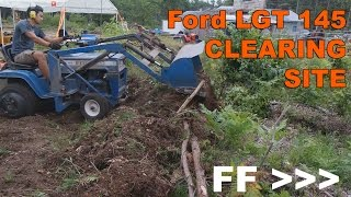Ford LGT 145 Front End Loader Bulldozing Clearing Site